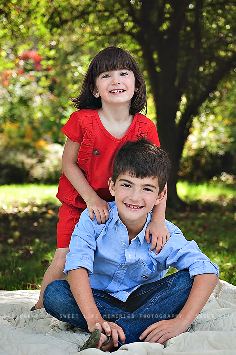 happy sibling posing for a portrait