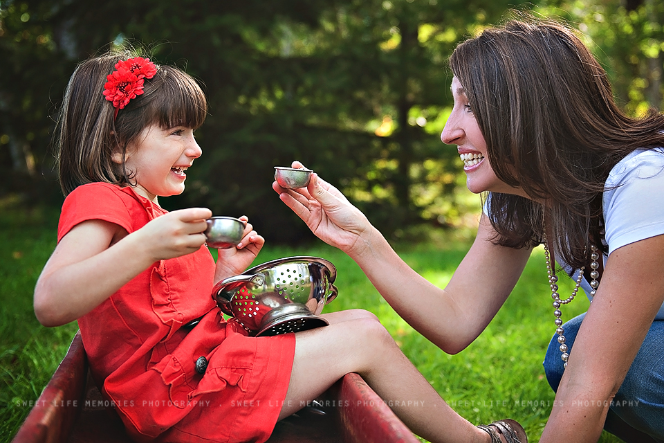 mom and daughter toasting at a tea party