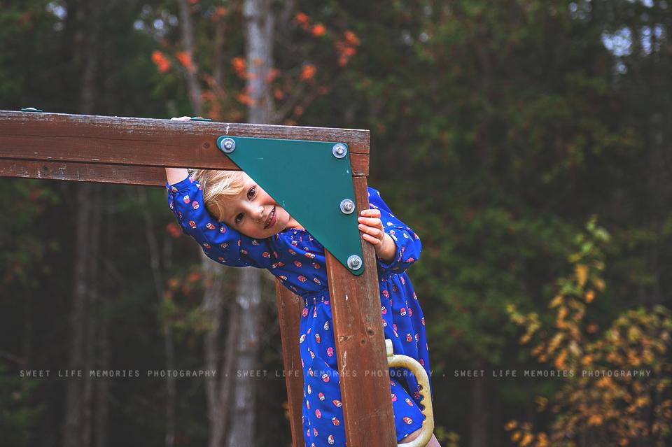 cute kid climbing on playground