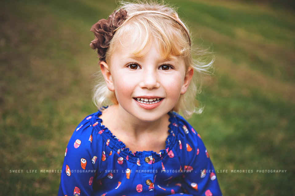 close up of little girl with blonde hair