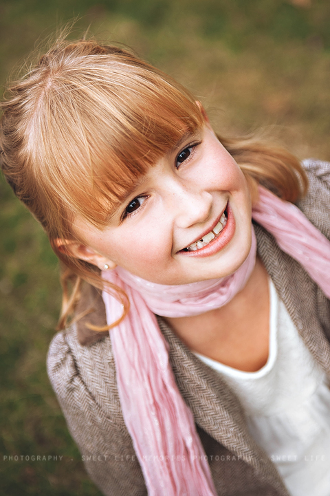 girl with a pretty pink scarf