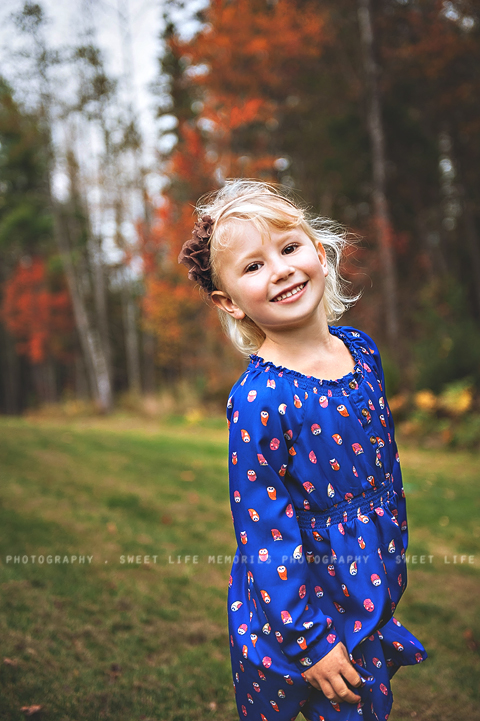 smiling little girl with fall colors