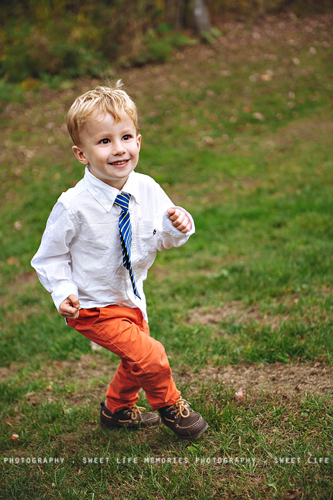 fashionable boy running in orange pants and a tie