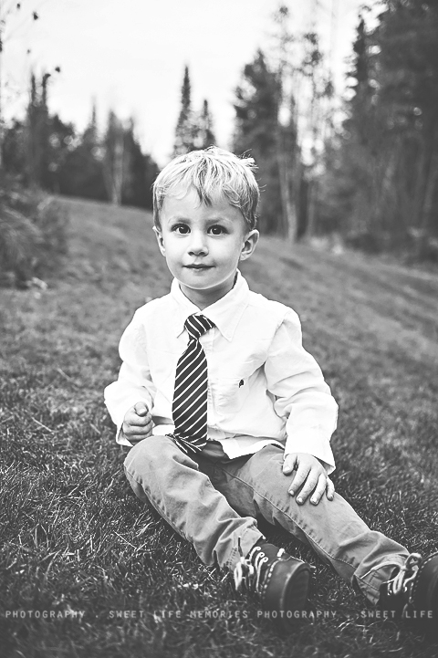 black and white portrait of a handsome little boy