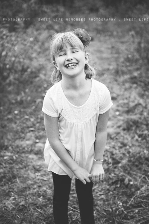 black and white portrait of a beautiful little girl laughing