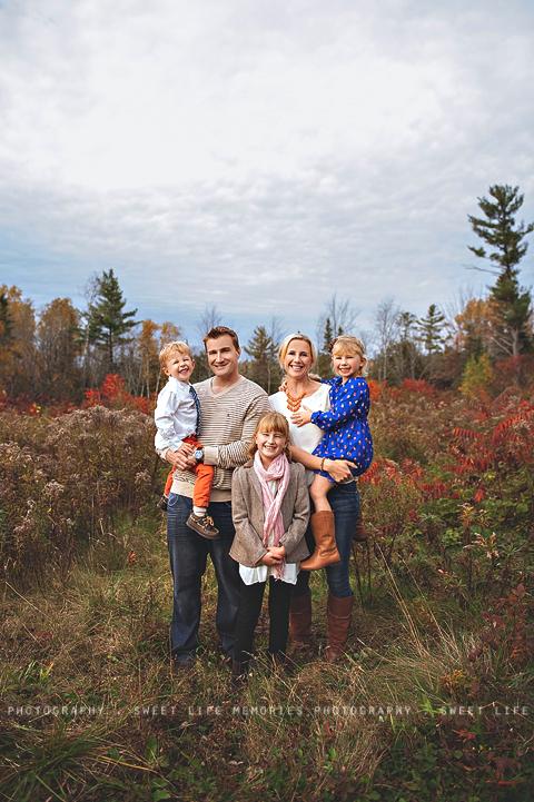 fall family portrait in a field