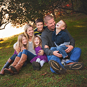 candid family pictures outside at a beautiful farm
