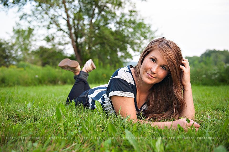 senior girl lying in the grass