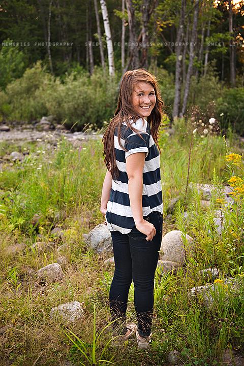senior girl standing in nature
