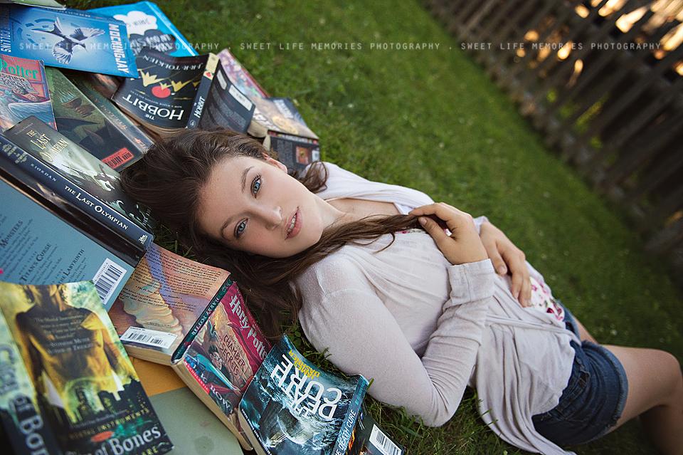 senior laying in books