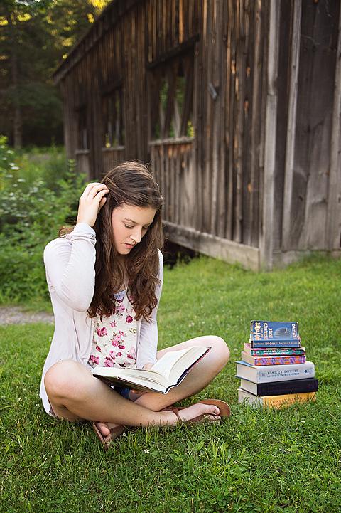 senior reading outside