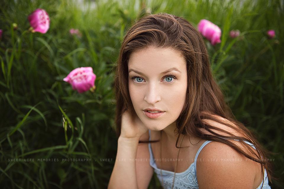 senior girl with pink peonys
