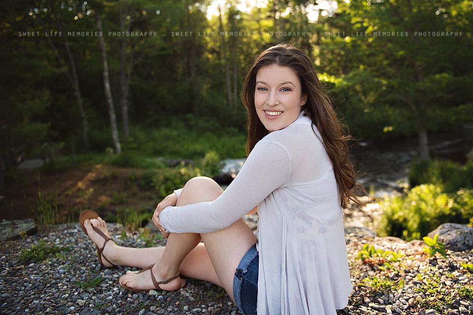 senior girl by a stream
