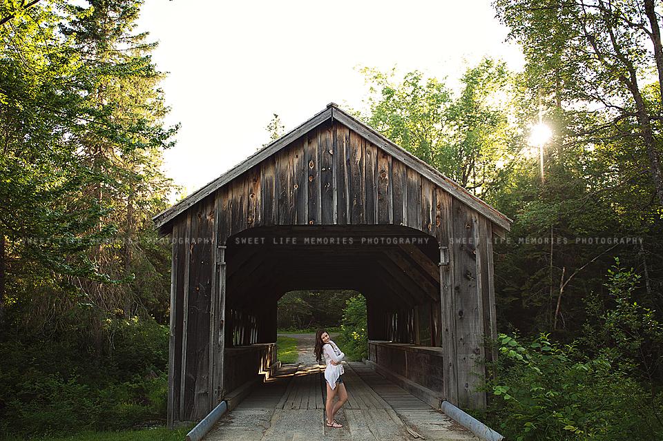 senior on covered bridge