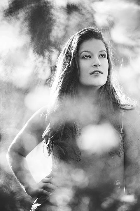 senior model black and white through leaves